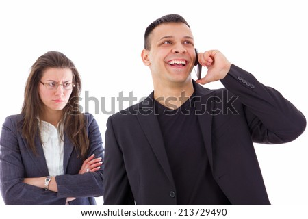 angry jealous woman suspecting on infidelity while her man is talking on the phone - stock photo