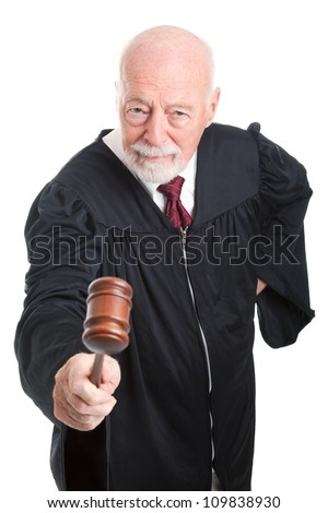 Angry judge bangs his gavel.  Isolated on white. - stock photo