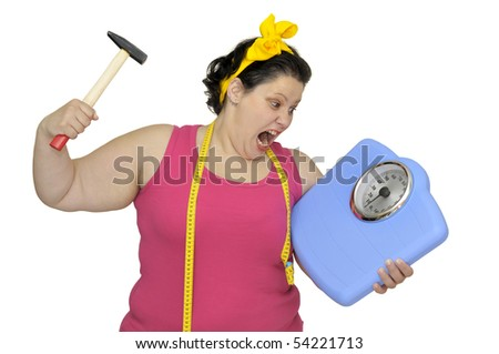 Angry large girl with hammer and scale isolated in white - stock photo