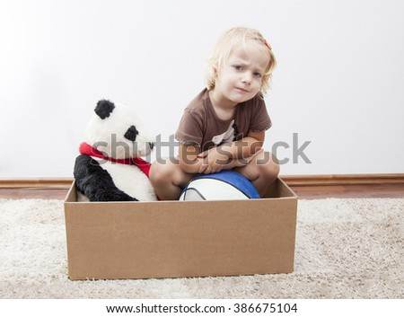 angry little girl - have to move - stock photo