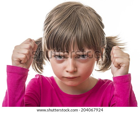 angry little girl on white background - stock photo