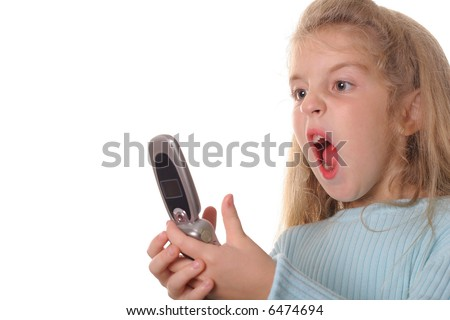 angry little girl screaming on cellphone - stock photo