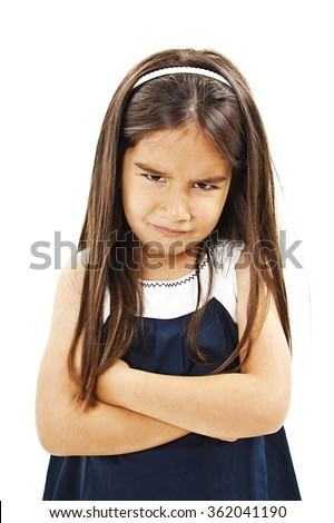 Angry little girl whit folded hand. Isolated on white background - stock photo