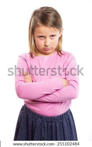 Angry little girl with crossed arms - stock photo
