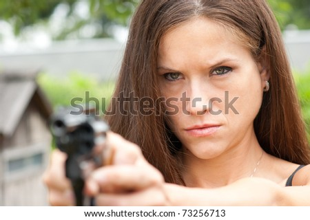 Angry Looking Woman Points 38 Special Snub-nose Revolver Gun - stock photo