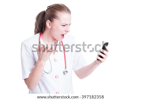Angry mad doctor or medic woman yelling at phone as video call concept - stock photo