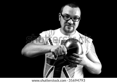 Angry man going to pop baloon - stock photo