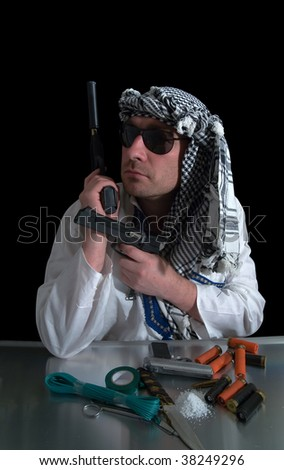 angry man holding a guns against black background