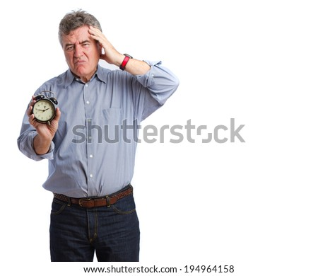Angry man holding an alarm clock