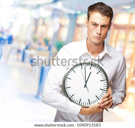 Angry Man Holding Clock In His Hand, Indoor