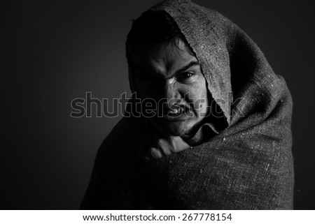 Angry man in a low key - stock photo