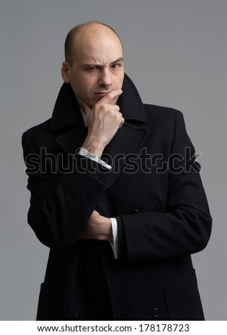 angry man over gray background