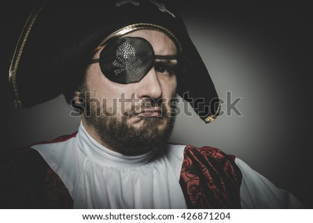 Angry man pirate with eye patch and old hat with funny faces and expressive - stock photo