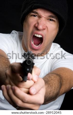 Angry Man Pointing Gun - stock photo