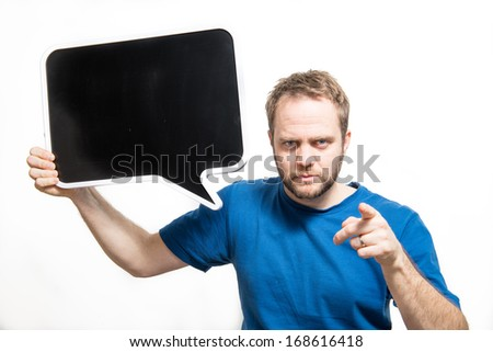 Angry man points finger while holding blackboard for your text - stock photo
