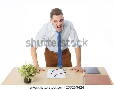 angry man screaming in office - stock photo