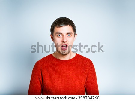 angry man shouting isolated on a gray background - stock photo