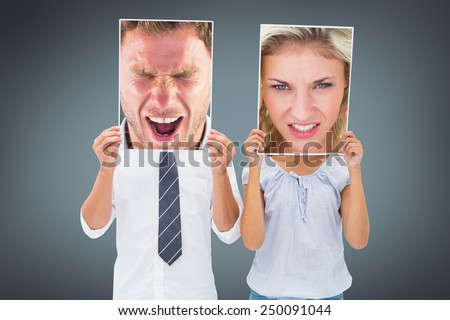 Angry man shouting towards camera against grey vignette - stock photo