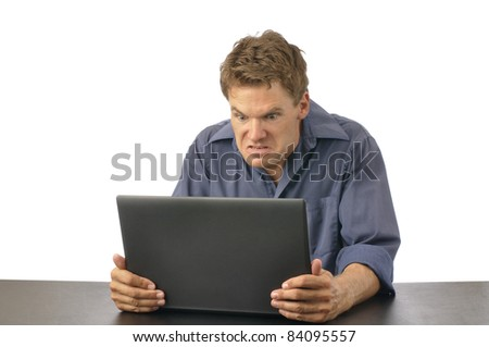 Angry man strangles laptop computer on white background