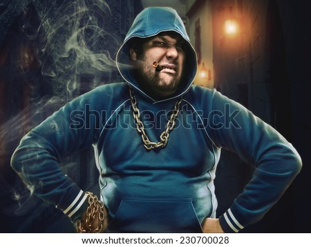 Angry man with a cigarette in the street - stock photo