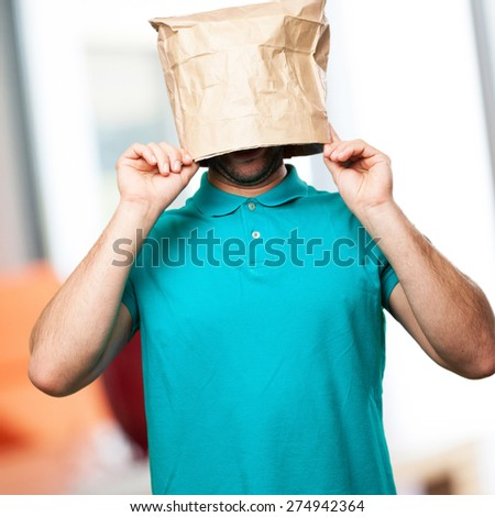 angry man with a paper bag in his head - stock photo
