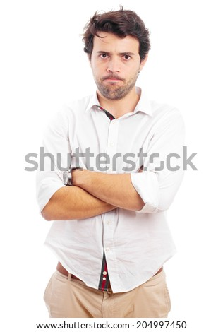 angry man with arms crossed - stock photo