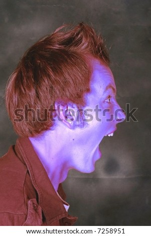 Angry man with blue face. - stock photo