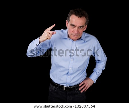 Angry Middle Age Business Man Shaking Finger Black Background - stock photo