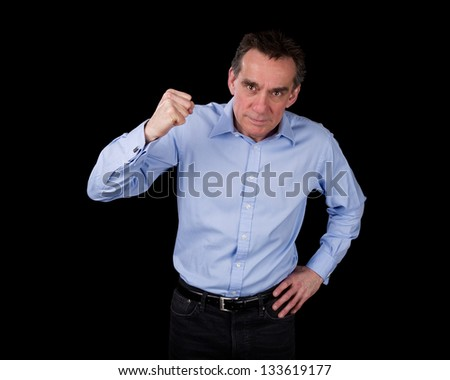 Angry Middle Age Business Man Shaking Fist Black Background