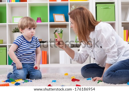 Angry mother scolding a disobedient child - stock photo