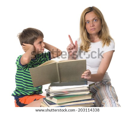 angry mother trying to teach her son while he is confronting  - stock photo