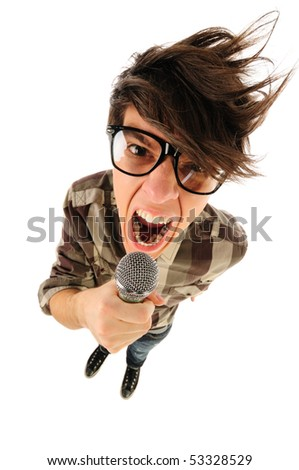 Angry nerdy guy with thick glasses shouting in the microphone, humor style, from above, isolated on white - stock photo