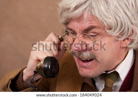 Angry Old Man On The Telephone. - stock photo