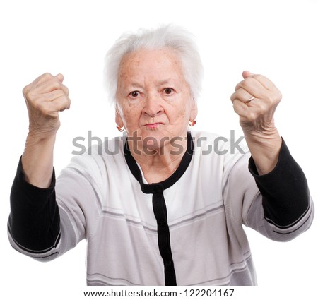 Angry old woman making fists on white background