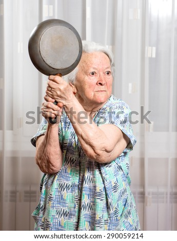 stock photo angry old woman with a pan at home 290059214 angry old woman stock images, royalty free images & vectors