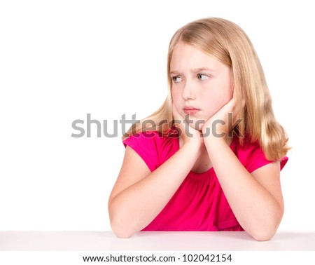 Angry or upset child looking to the side isolated on white - stock photo