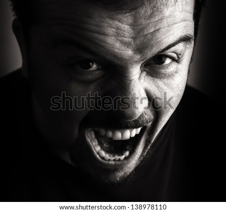 Angry person portrait. Black and white shot. - stock photo