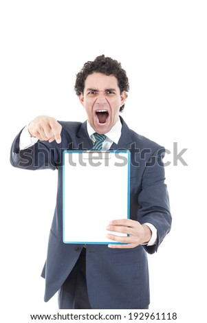angry  pissed off man in suit holding up a banner or notes against a white background and showing with his hand blank space for message. Cardboard placard is blank ready for your message. - stock photo