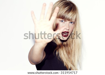 Angry refusal from young blond woman, portrait
