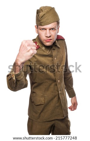 Angry russian soldier threaten with a fist. Studio portrait isolated on white background  - stock photo