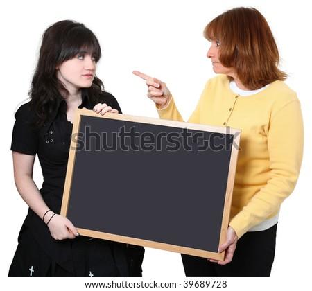 Angry school teacher and highschool student holding chalkboard. - stock photo