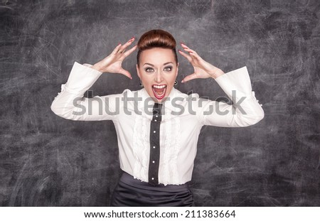 Angry screaming teacher  - stock photo