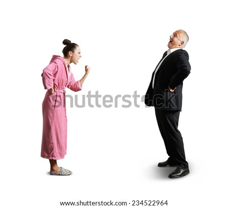 angry screaming woman showing fist laughing senior man. isolated on white background - stock photo
