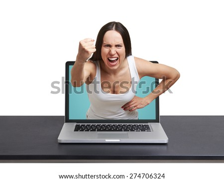 angry screaming woman stretching out of laptop and showing fist at camera against white background - stock photo