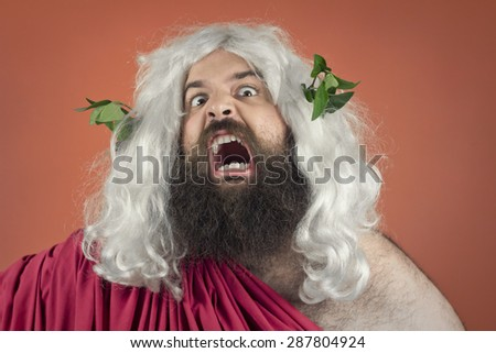 Angry screaming wrath of god against orange background - stock photo