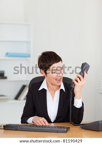 Angry secretary calling in her office - stock photo
