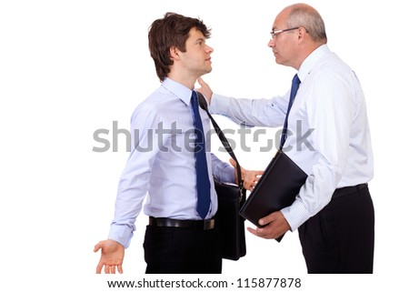 Angry senior businessman has an argue with young attractive businessman, isolated on a white background - stock photo