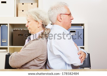 Angry senior couple having a silent fight at home - stock photo