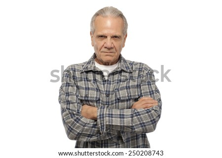 Angry senior man with arms crossed against white background
