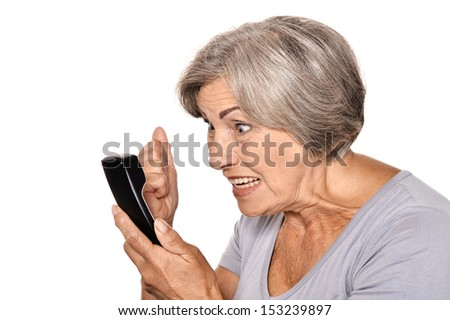 Angry senior woman talking phone isolated on white